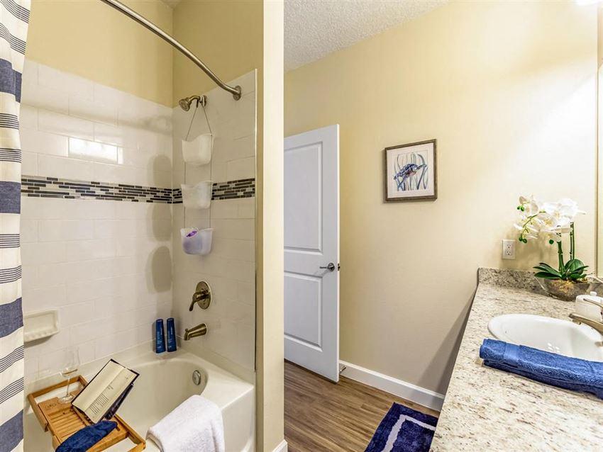 bathroom with wood-style flooring