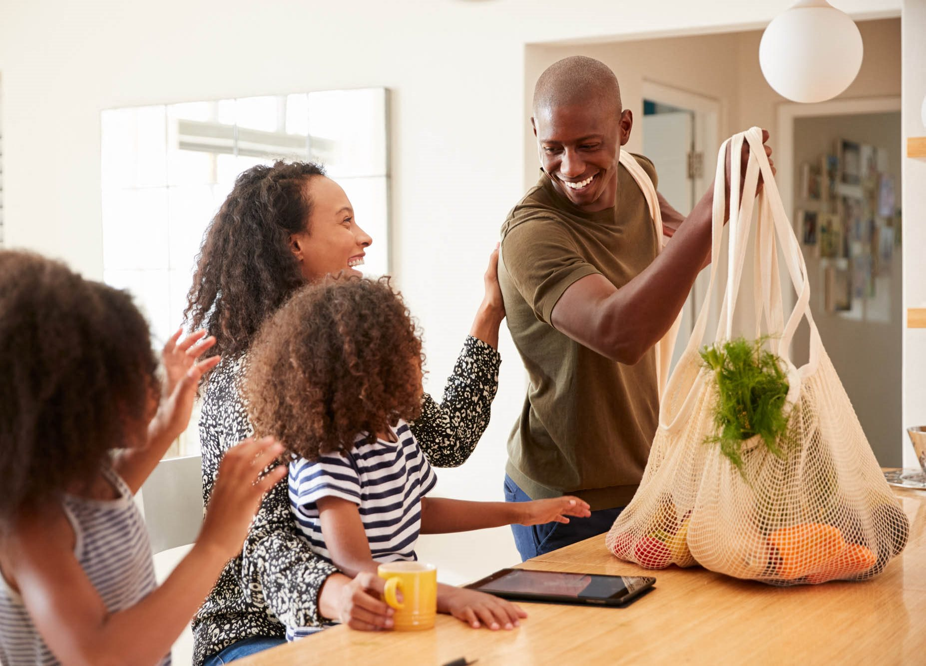 stock image- family in kitchen after grocery shopping