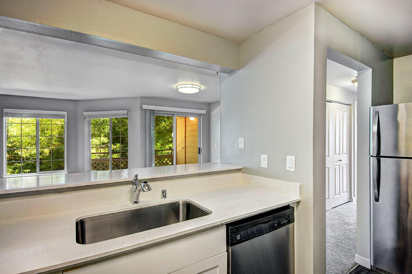 renovated unit kitchen features stainless steel appliances
