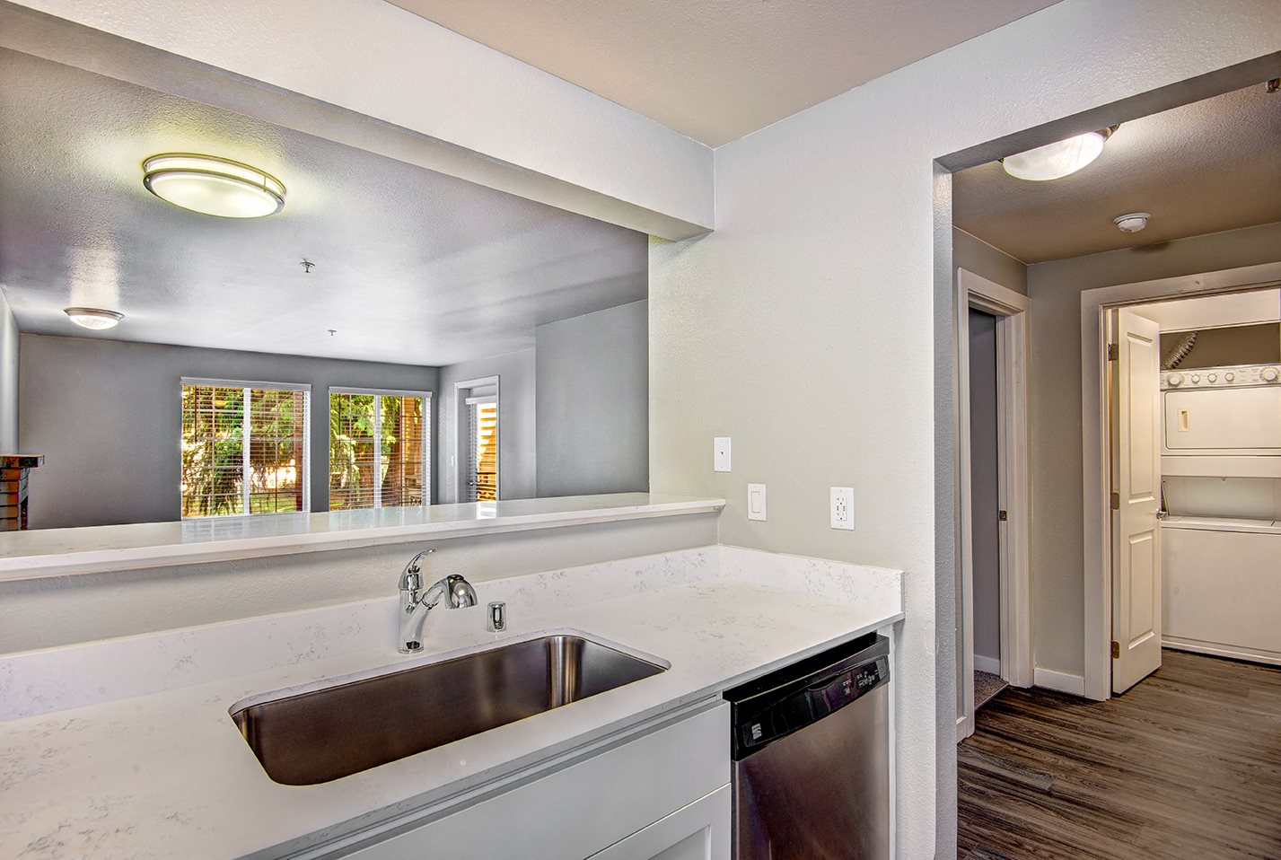 renovated unit kitchens feature white cabinets and equipped with stainless steel appliances