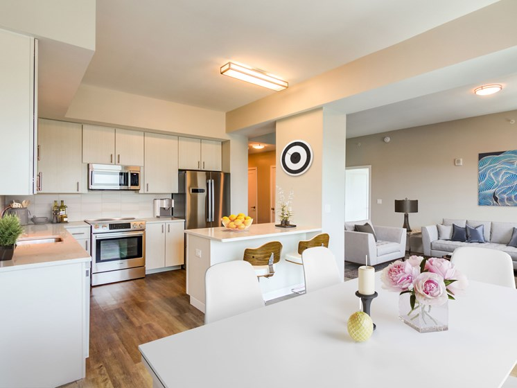 penthouse kitchen and dining area with living room in background