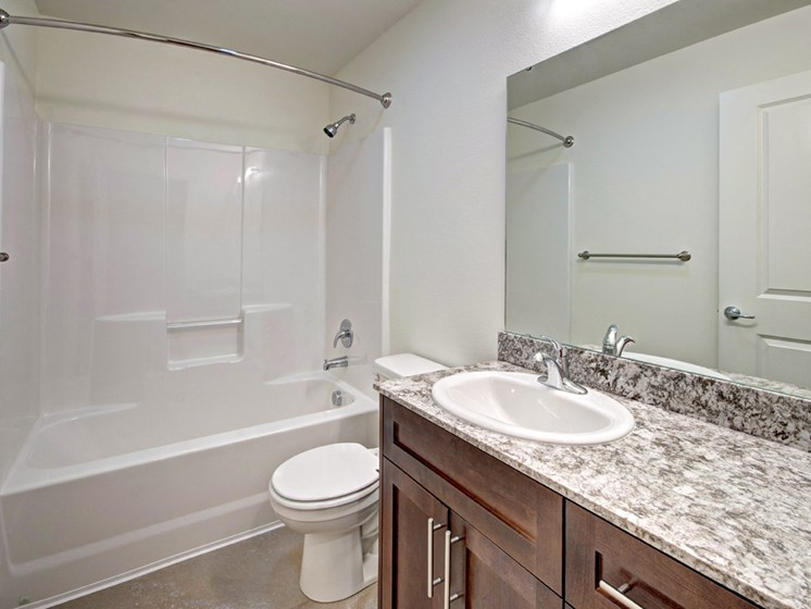 Large Soaking Tub In Master Bathroom with A Tile Surround at Emerald Crest, Bothell Washington