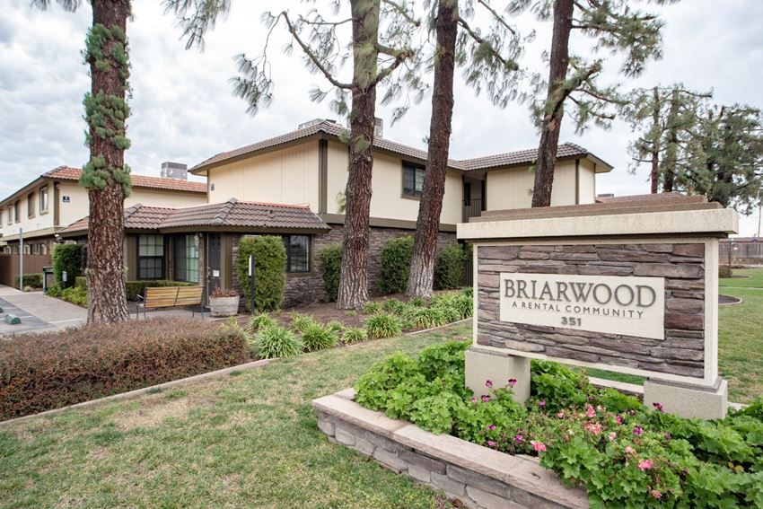 Pet-Friendly Apartments in Turlock CA - Briarwood Exterior with Lush Greenery and a Prime Location Near the Best Dining, Shopping, and Nightlife Experiences
