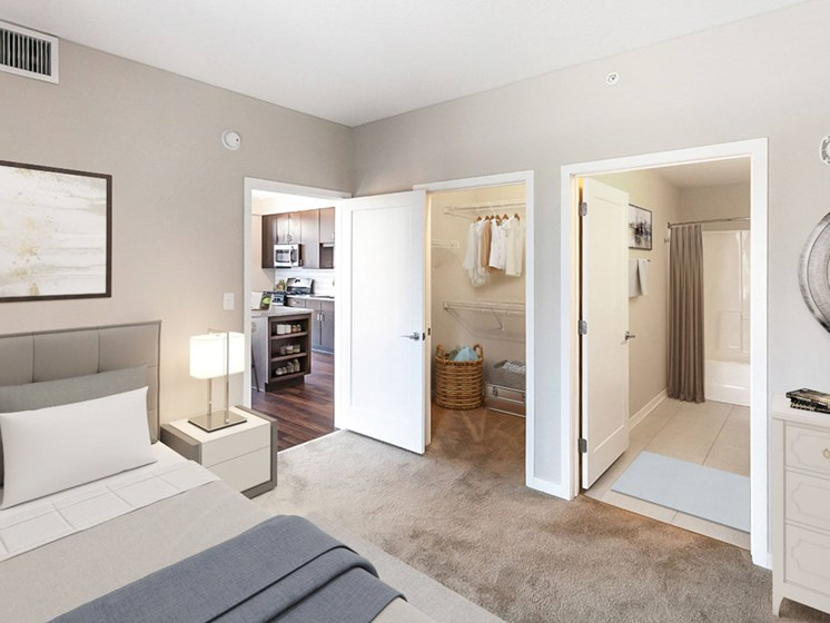 bedroom with adjacent bathroom
