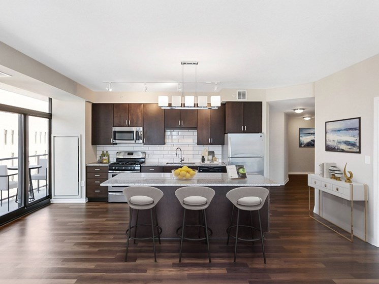 updated kitchen with stainless steel appliances and counter tops