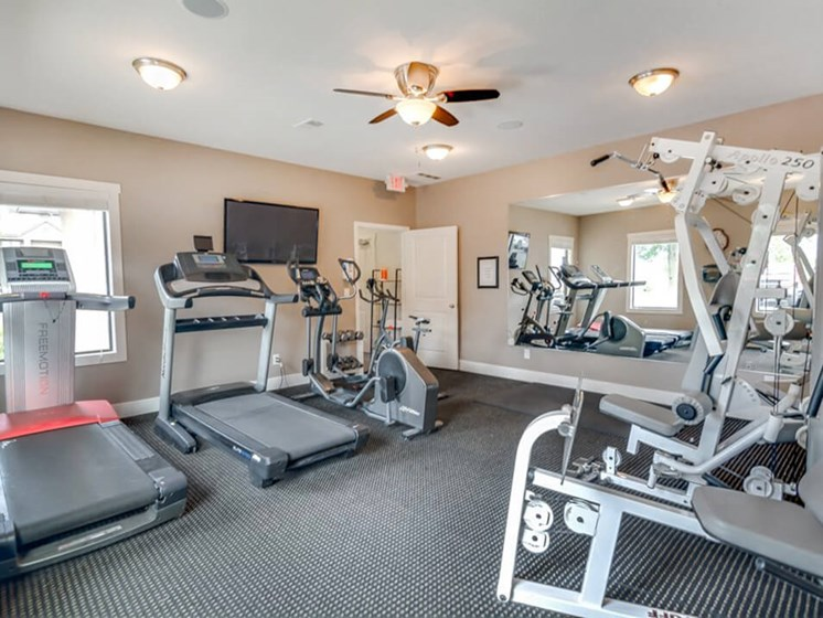 fitness center at The Hill's Apartments