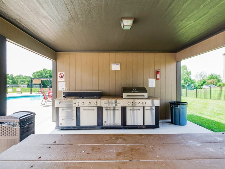 outdoor grill at The Hills apartments