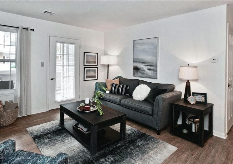 Spacious Living Room at Village Woods Apartments in Milan, IL