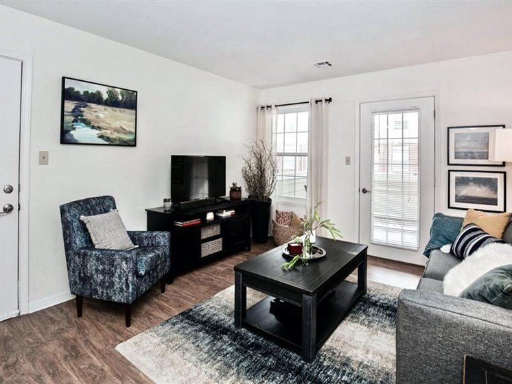 Living Room at Village Woods Apartments in Milan, IL
