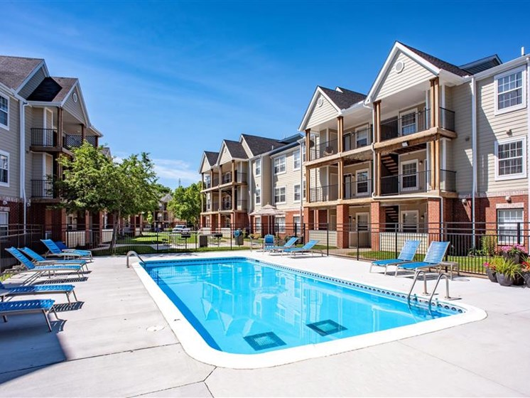 Outdoor Swimming Pool at Village Woods Apartments in Milan, IL