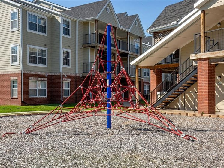 Playground at Village Woods Apartments in Milan, IL