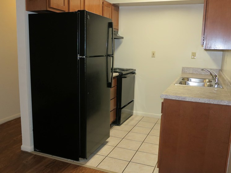black appliances in kitchen at Waterstone Place