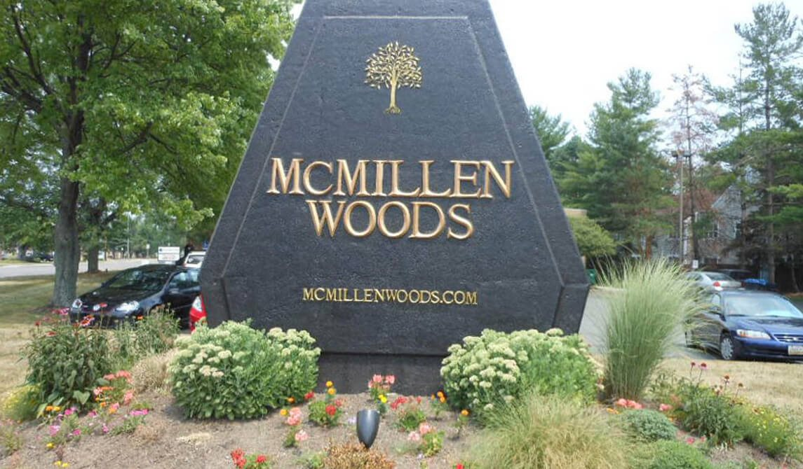 welcome sign at McMillen Woods Apartments