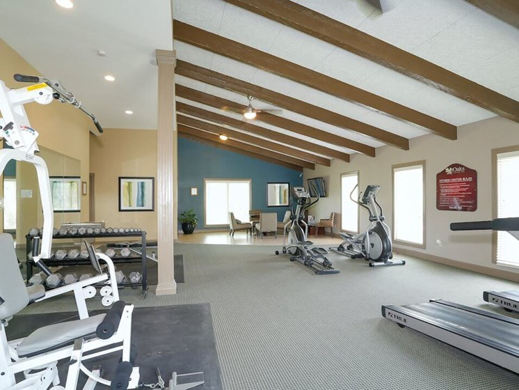 Fitness center at The Oaks at Prairie View Apartments