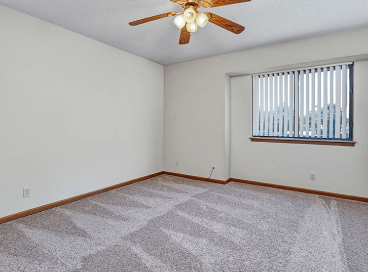 apartment bedroom with ceiling fan