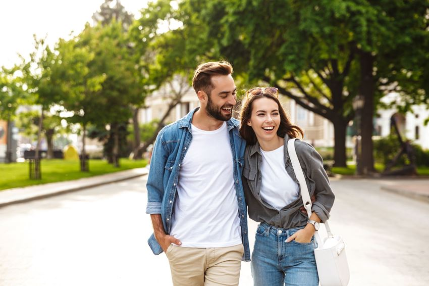 Two friends walking outdoors
