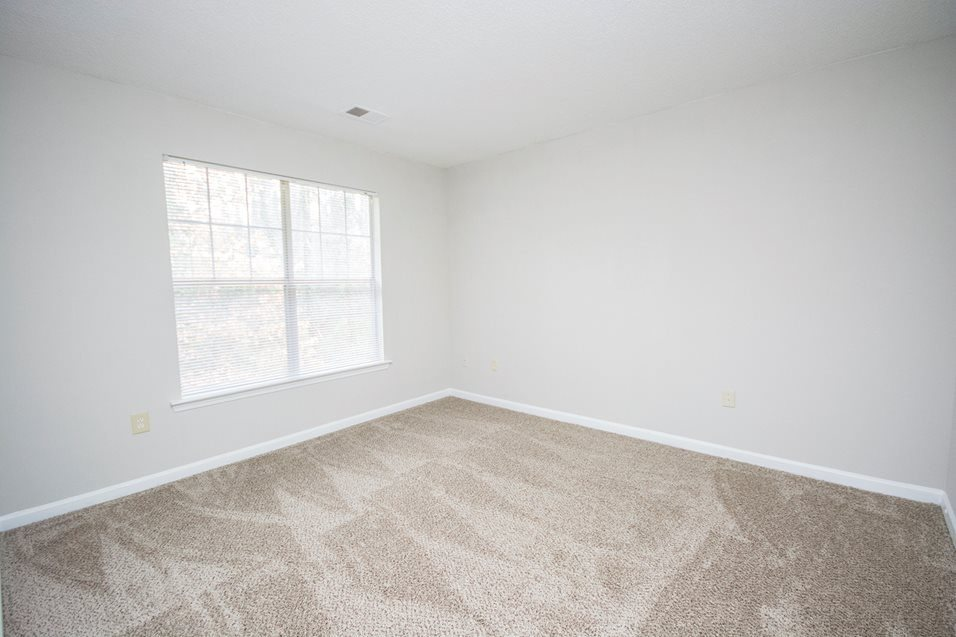 Renovated bedroom at The Avalon apartment homes in Charlotte, NC