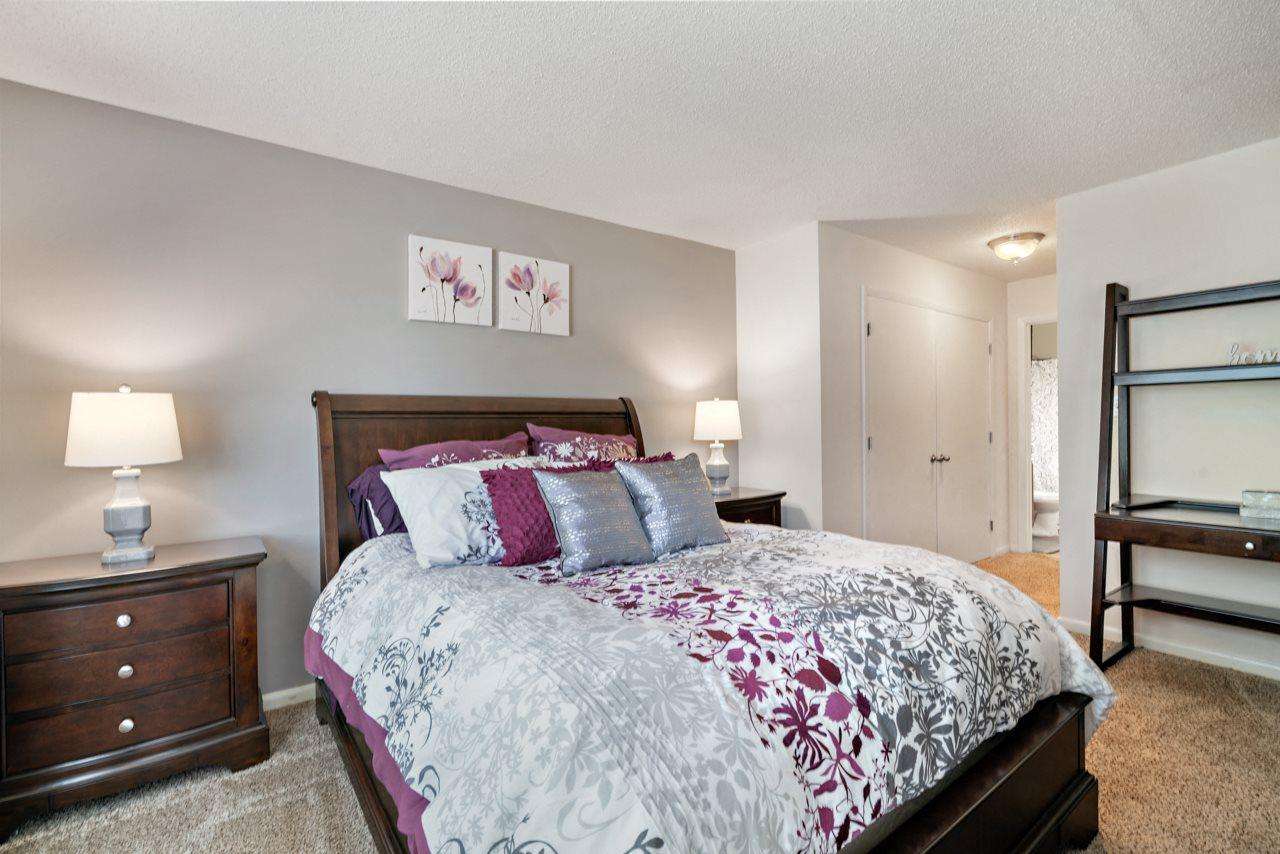 Model Floor Plan Cozy Bedroom at Avenues at Steele Creek Apartments
