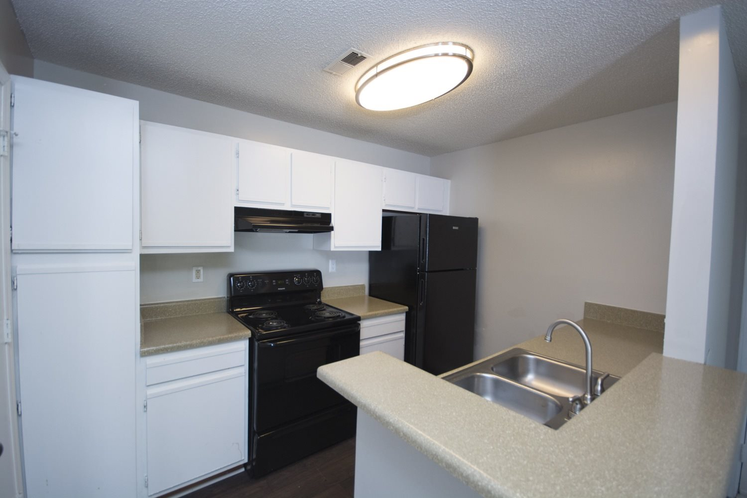 Kitchen with black energy efficient appliances at Axiom Apartments in Charlotte, North Carolina