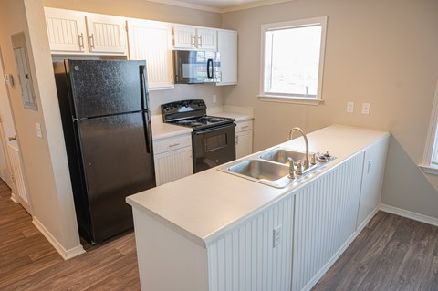 Spacious kitchen in your new home at Deerbrook Apartments in Wilmington, NC 28405