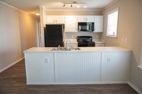 Beautiful kitchen in Deerbrook Apartment homes with spacious countertops and overhead lighting