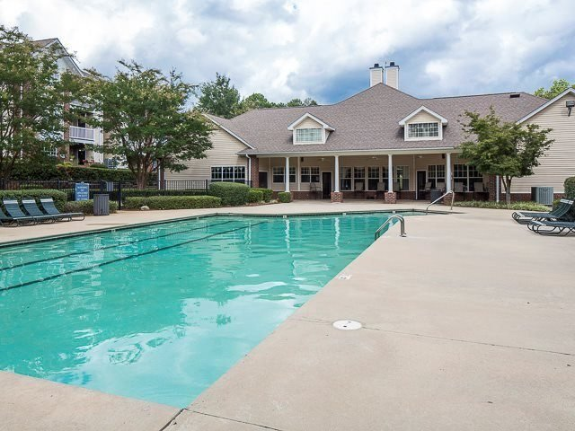 Sparkling swimming pool with spacious sundeck at The Avalon in Charlotte, NC