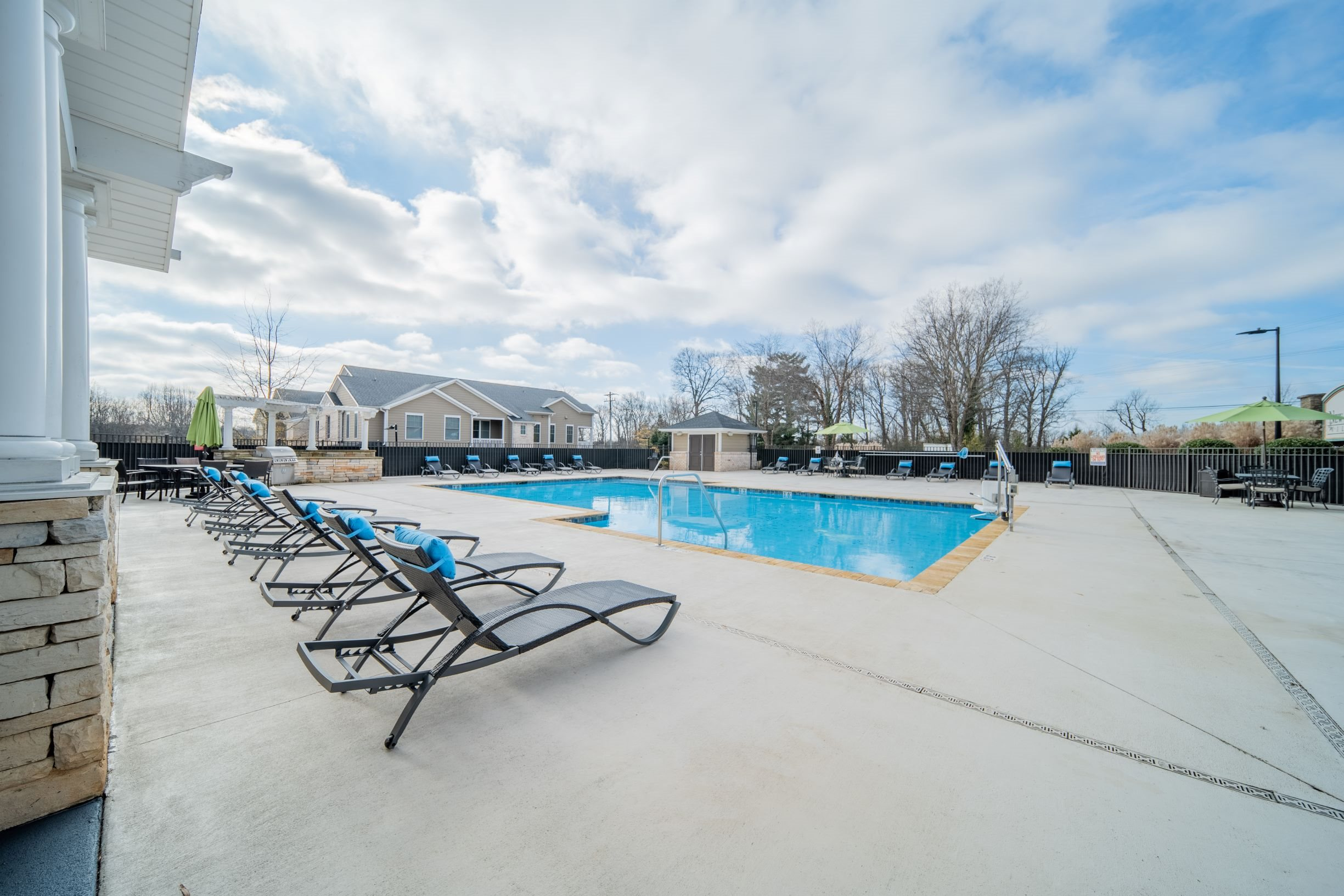 Sparkling swimming pool and spacious sundeck at Piedmont Place apartments in Greensboro, NC