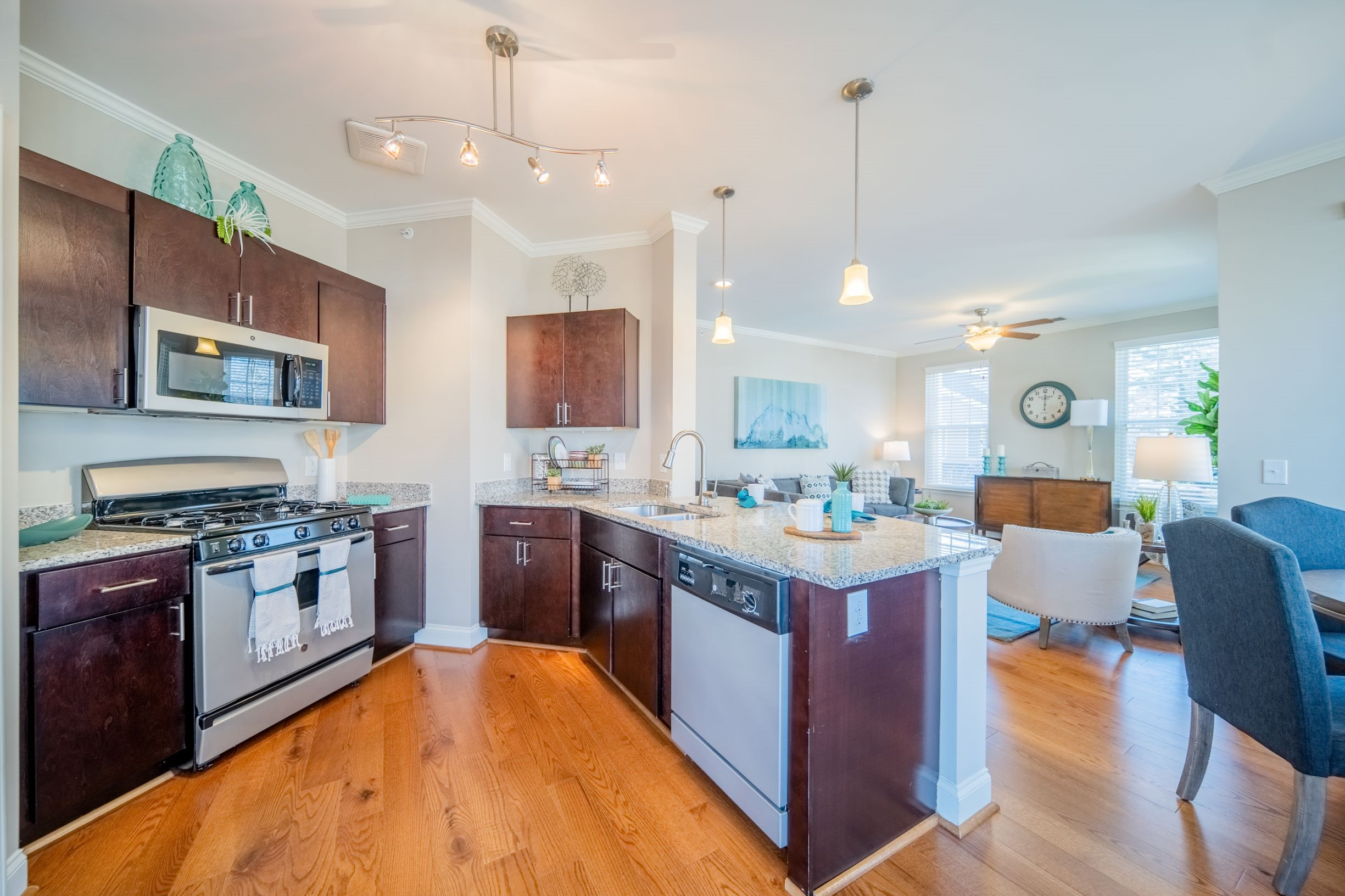 Fully-equipped kitchen with granite countertops and stainless steel appliances at Piedmont Place in Greensboro, NC