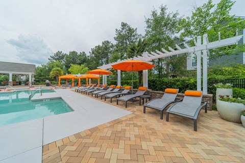 Sparkling swimming pool and spacious sundeck at The Oxmoor in Birmingham, AL