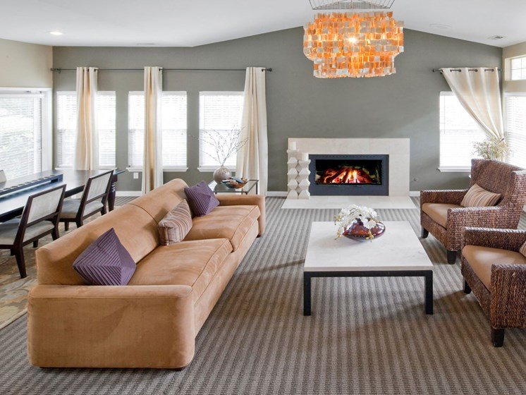 Resident clubhouse with fireplace and dining area at Landmark at Tanasbourne Apartments in Hillsboro, OR 97124