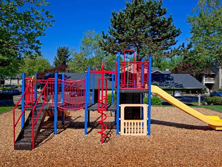 Playground area with slide at Landmark at Tanasbourne Apartments in Hillsboro, OR 97124