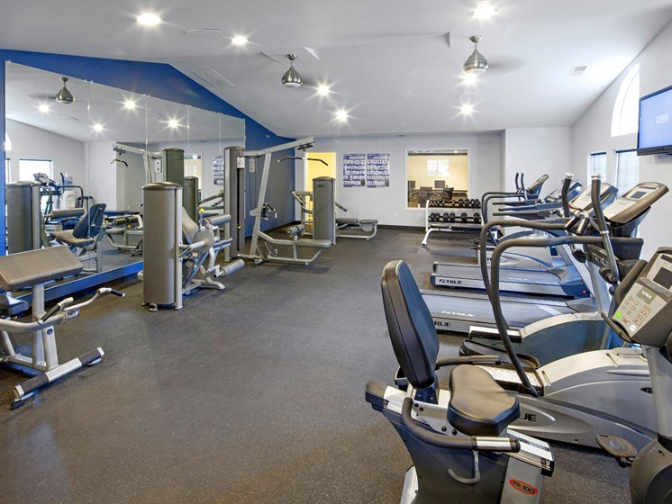 Fitness center with cardio machines and free weights at Landmark at Tanasbourne Apartments in Hillsboro, OR 97124