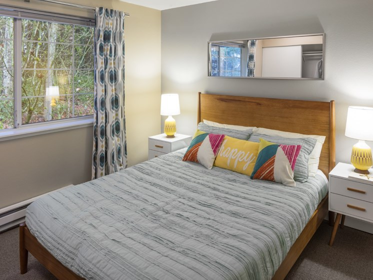 Bedroom with carpeting at Landmark at Tanasbourne Apartments in Hillsboro, OR 97124