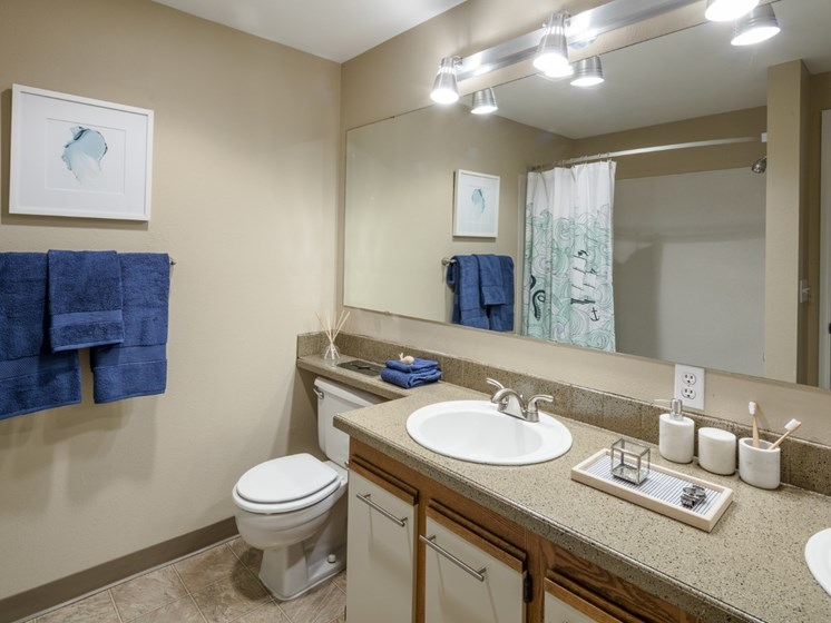 Full Bathroom with double sink vanity area at Landmark at Tanasbourne Apartments in Hillsboro, OR 97124