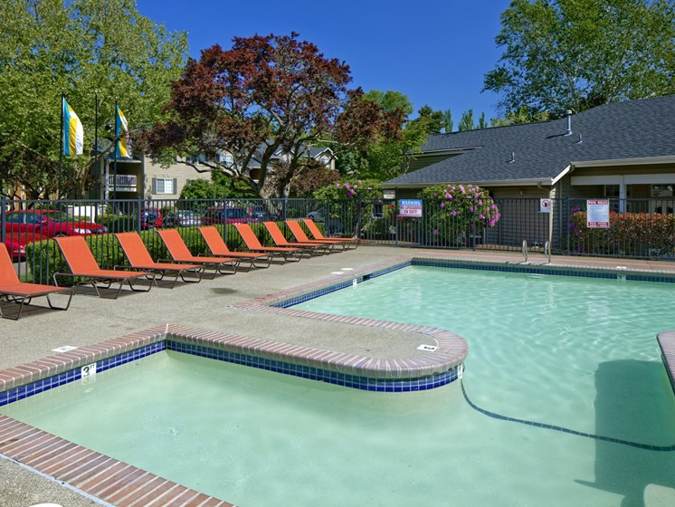 Swimming pool with sundeck at Landmark at Tanasbourne Apartments in Hillsboro, OR 97124