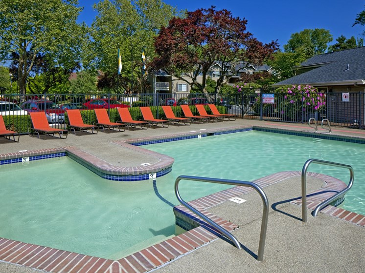 Large swimming pool with sundeck at Landmark at Tanasbourne Apartments in Hillsboro, OR 97124