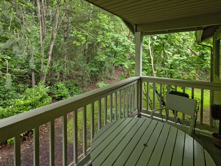 Views of wooded area from private balcony at Landmark at Tanasbourne Apartments in Hillsboro, OR 97124
