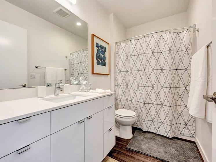 White Bathroom Interiors  at Shelton Eastlake apartments in Seattle, Washington