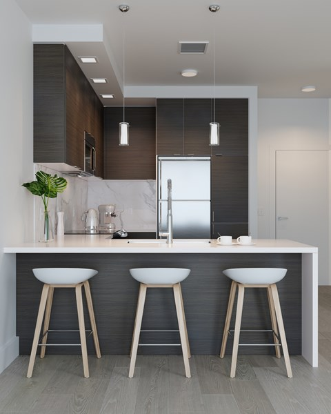 Kiitchen with Dark Finishes featuring Island with Waterfall Edge, Stainless Steel Whirlpool Appliances