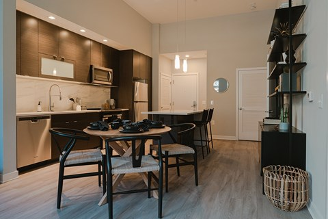 Spacious Dining Area and Kitchen with Center Island at Arrowwood Apartments