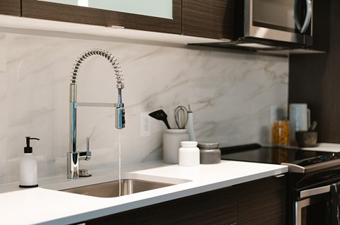 Elevated Finishes at Arrowwood Apartments  - Kitchen fa