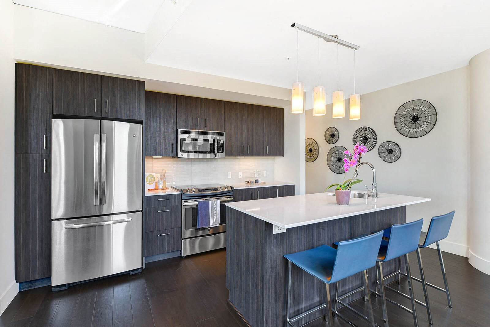 French-Door Refrigerator, Kitchen Islands And Quartz Countertops In Chef-Inspired Kitchens at Cirrus, 2030 8th Avenue, Seattle