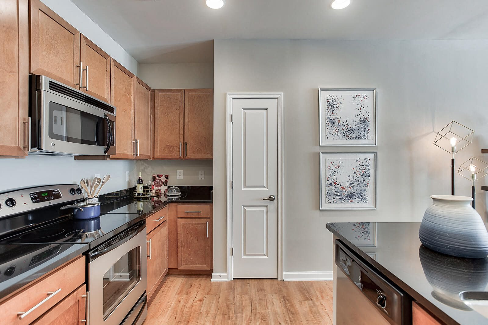 Stainless Steel Appliances And Wood Cabinetry in Kitchens at The Ridgewood by Windsor, Fairfax, Virginia