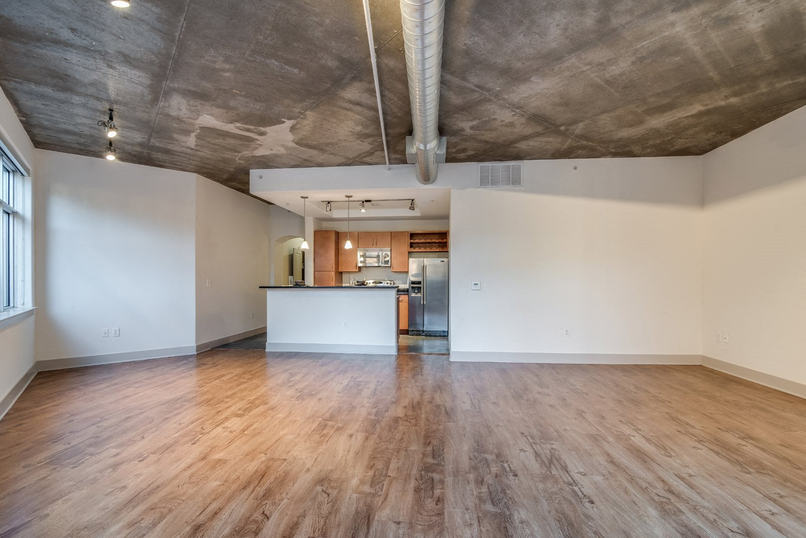 Hardwood Flooring and Exposed Concrete Ceilings at Crescent at Fells Point by Windsor, 951 Fell Street, Baltimore