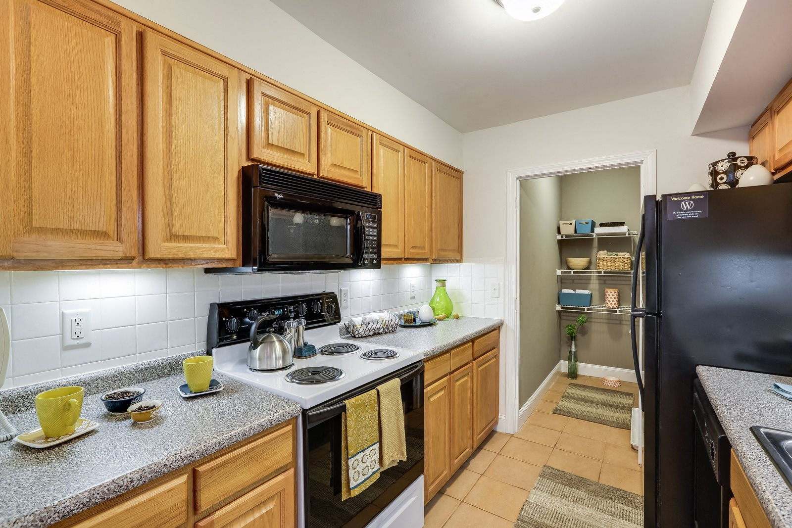 Kitchen with Double Sink and Garbage Disposal at Windsor Village at Waltham, Waltham, MA