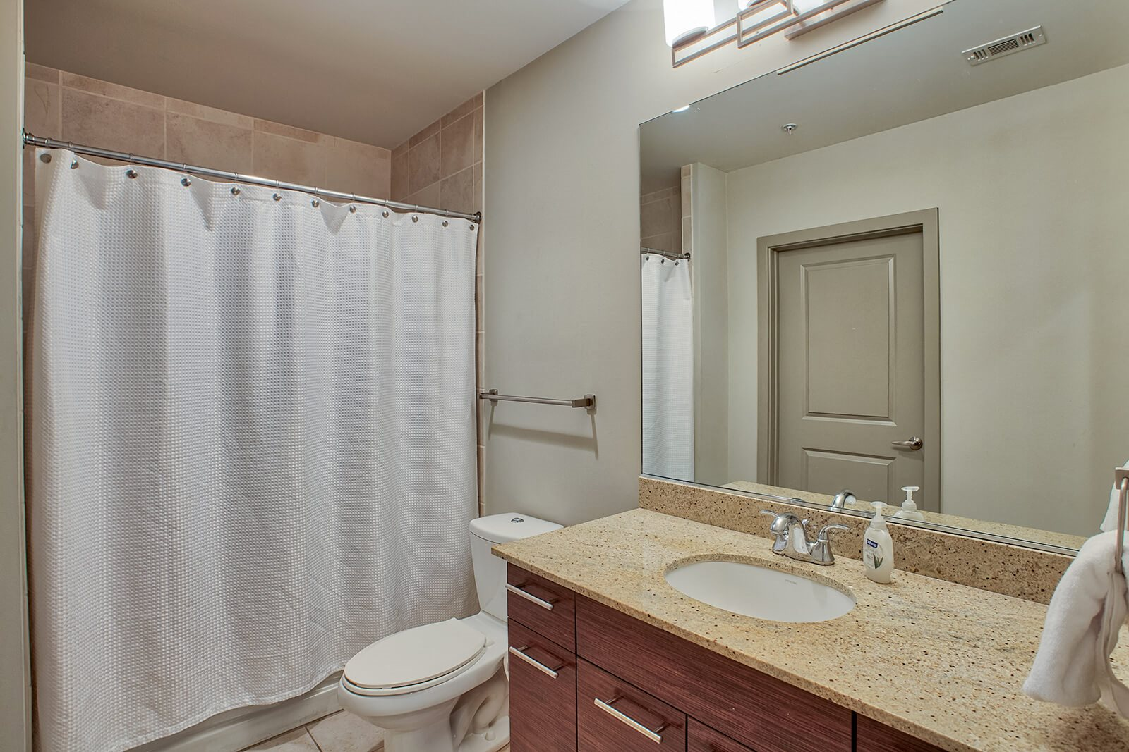 Showers and Soaking Tubs in Bathrooms at Glass House by Windsor, Dallas, Texas