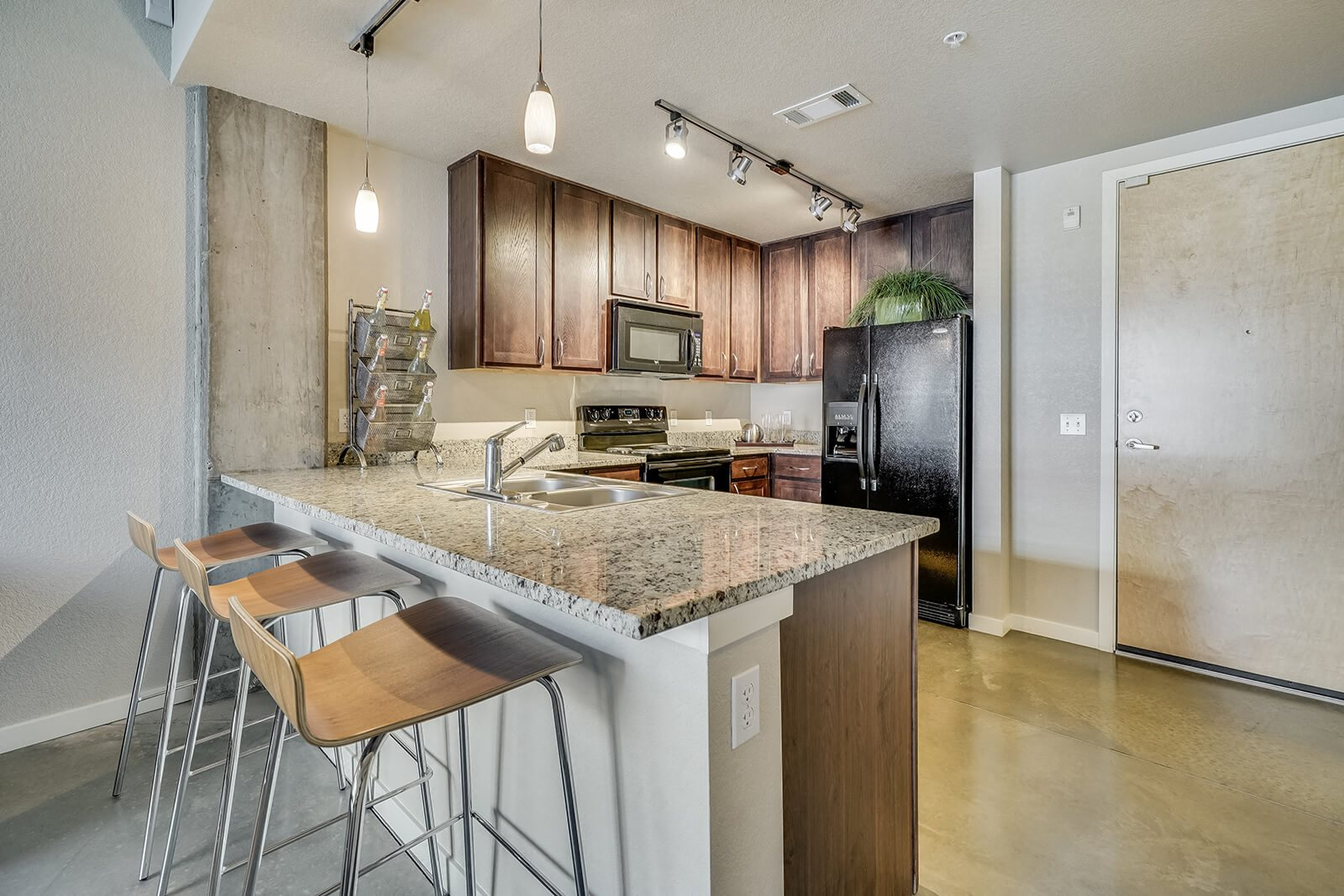 Granite Countertops and Hardwood Cabinets at Windsor at Broadway Station, Denver, CO