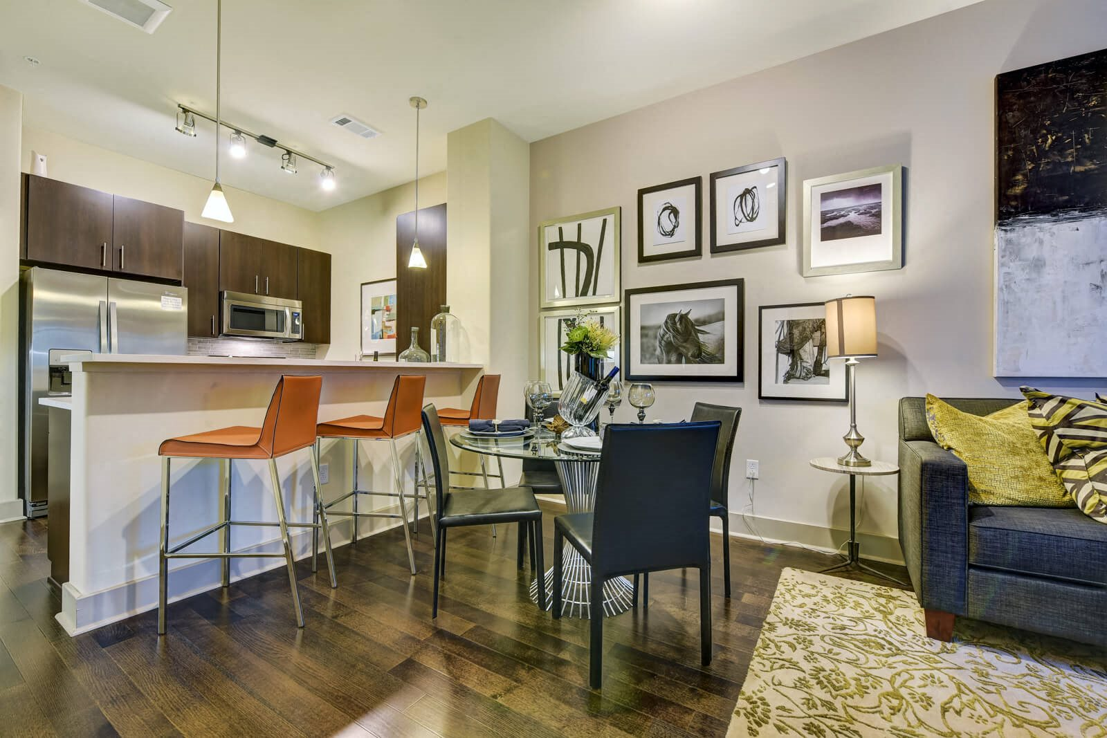 Open Flow Living Rooms with Wood Flooring at Windsor at Cambridge Park, Cambridge, Massachusetts