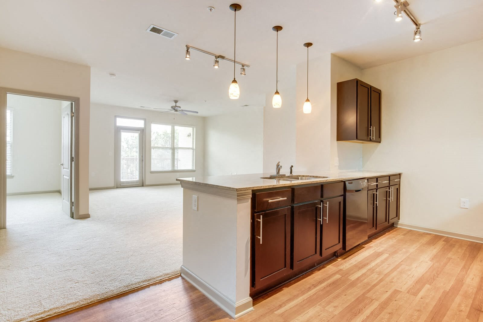 Living Spaces With Pendent Lights at Windsor at Glenridge, Georgia, 30342