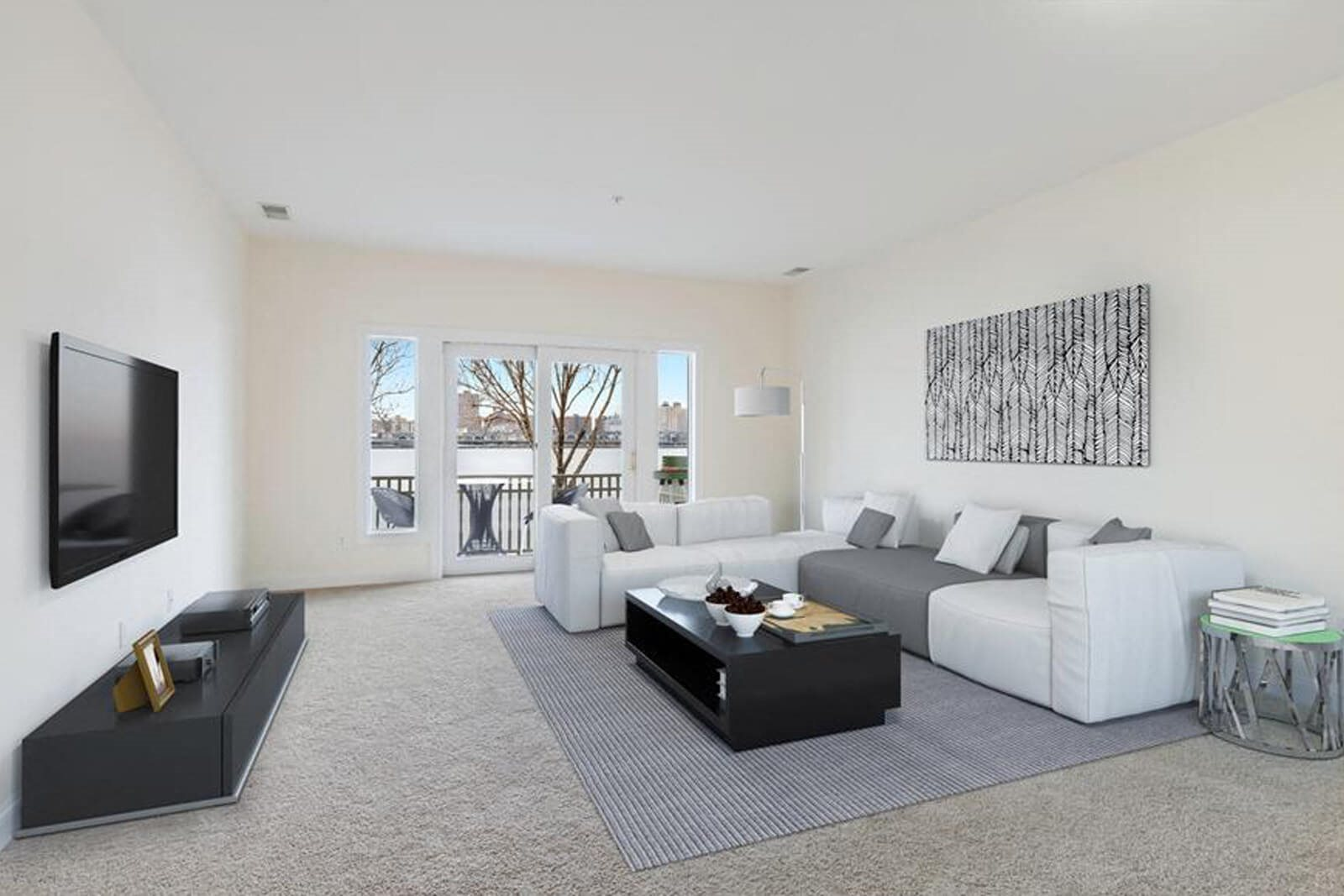 Spacious Living Room with French Doors to Balcony at Windsor at Mariners, Edgewater, NJ